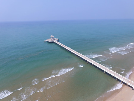 sea view: aerial view of pier bridge into blue sea Stock Photo