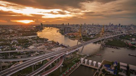 land transportation: aerial view of bhumiphol bridge crossing chaopraya river important landmark and  land transportation in bangkok thailand