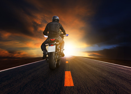 motorcycle road: young man riding big motorcycle on asphalt highway use for people leisure and motorsport activities Stock Photo