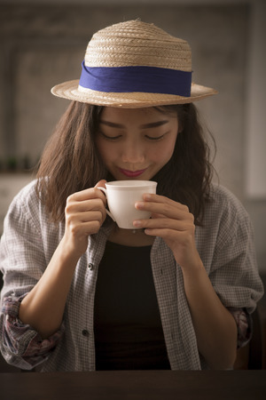 beautiful asian woman and hot coffee cup happiness smiling face
