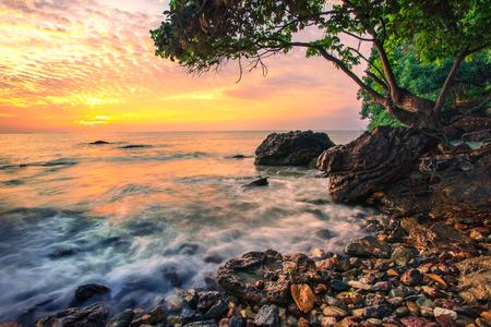awe: beautiful sea scape dramatic sky morning sun rising  of wang kaew rayong eastern of thailand