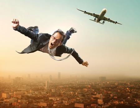 business man flying from passenger plane flying over sky scraper