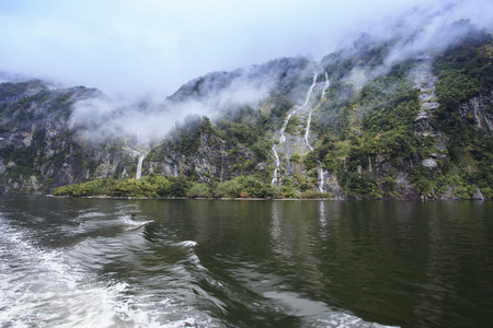fiordland: water falls in milford sound fiordland national park new zealand important natural traveling destination Stock Photo