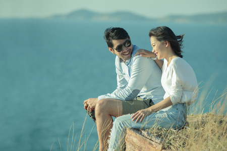 portrait of asian younger man and woman relaxing vacation at sea side happiness emotion Foto de archivo