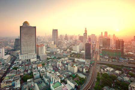 bangrak: beautiful city scape urban scene  of bangkok capital of thailand in morning light glow up view from peak of sky scrapper building
