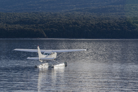anau: water plane floating over te anau lake fiordland national park new zealand