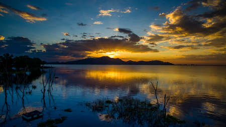 awe: beautiful scenic of sun set sky at bangpra reservoir lake in chonburi eastern of thailand Stock Photo
