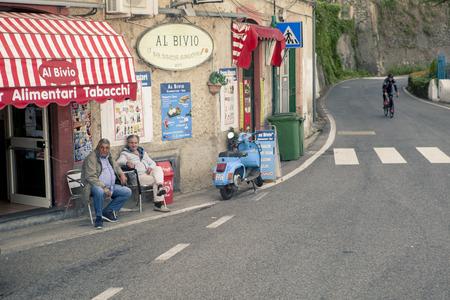 AMALFI COAST LINE SOUTH ITALY - NOVEMBER 5 : unidentified people sitting on desk beside road of amalfi coast line  on november 5, 2016 in naple amalfi south italy