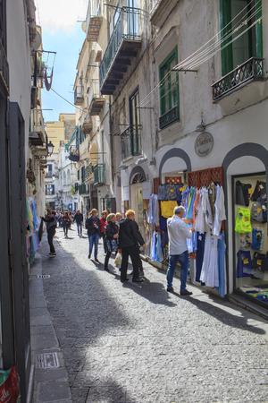 AMALFI TOWN SOUTH ITALY - NOVEMBER 5 : toursit walking in narrow street in amalfi town important traveling destination of mediterranean coast line on november 5, 2016 in amalfi town south italy