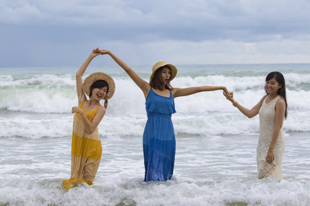 preety: younger asian woman relaixng vacation time at sea beach happiness emotion