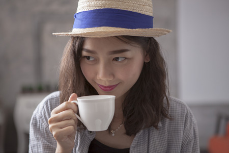 hot asian: beautiful asian woman and hot coffee cup happiness smiling face