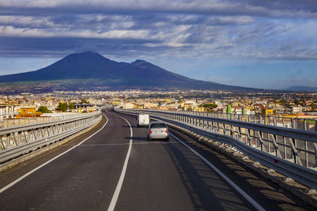 A one motorway from naple to rome passing naple town and vesuvius volcano scene
