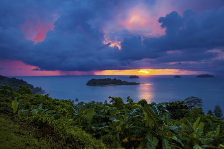 trad: raining over blue sea at  sunset time koh chang island trad eastern thailand Stock Photo