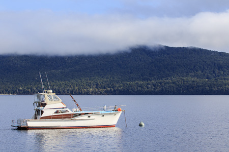 te: yachting boat in te anau lake fiord land national park new zealand important traveling destination