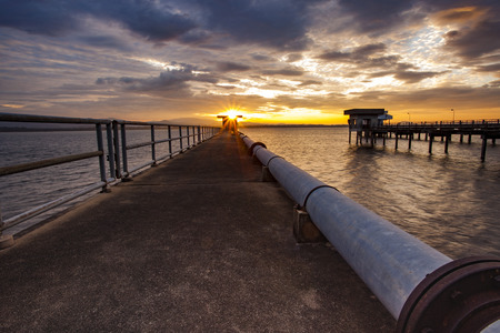 water scape: sun rising sky at bangphra reservoir and waterwork station in chonburi eastern of thailand Stock Photo