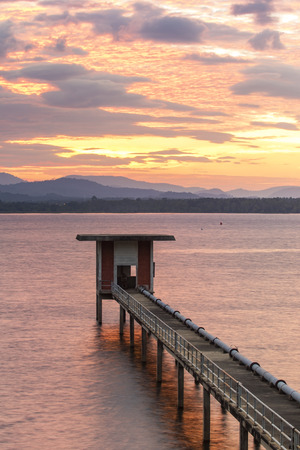 sun rising sky at bangphra reservoir and waterwork station in chonburi eastern of thailand Stock Photo