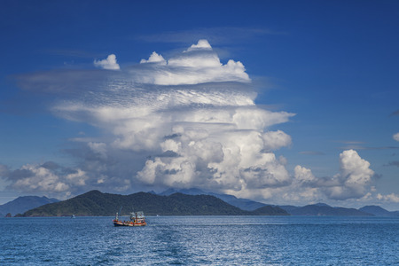 trad: fishery boat and blue sky white cloud koh chang trad thailand