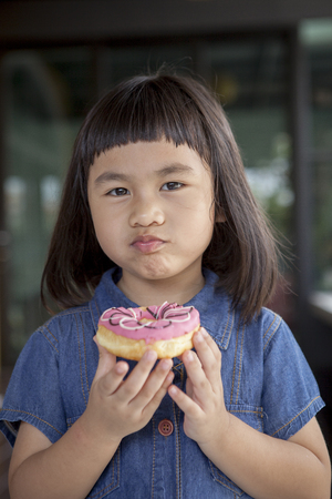 asian children happiness face with sweet candy in hand