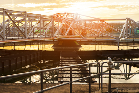 structure frame of water works in heavy industry estate plant agaisnt beautiful sunset sky light