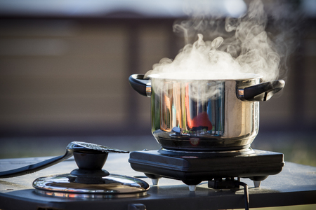 close up standless pot food  cooking on electric stove Stock Photo