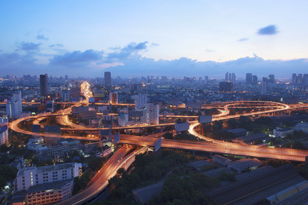 beautiful scenic top view of bangkok expressway and vehicle traffic roundabout  at twilight time Reklamní fotografie