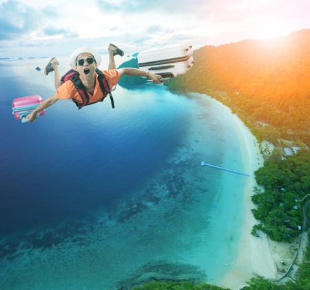 flying man happiness vacation time over beautiful blue sea traveling destination
