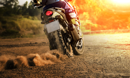 man riding sport touring motorcycle on dirt field Stock Photo - 78758149