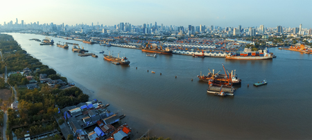 aerial view of klong tuey port and container ship floating in chao praya river bangkok thailand