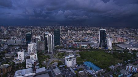 BANGKOK THAILAND - JUNE 7,2017 : aerial view of  high and modern office building at ratchadaphisek road and rainstroming cloud background