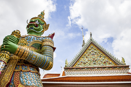 thai giant statue in wat arun temple most popular traveling destination and bright sky Stock Photo