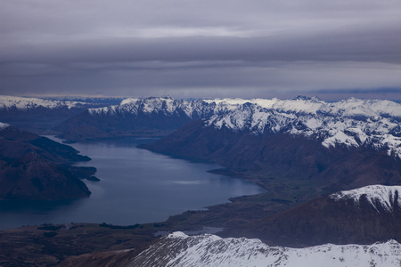 aerial view of snowcapped mountain and lake wakatipu south island new zealand