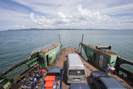 TRAD THAILAND - OCTOBOR 30, 2014 : ferry boat carrying land vehicle from koh chang island heading to trad port ,koh chang most popular traveling destination in eastern of thailand Redakční