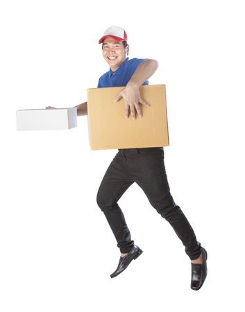 deliverer: delivery man holding carton box toothy smiling face with service mind isolated white background Stock Photo
