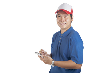 toothy smiling face of delivery man and smart computer in hand preparing for taking customer order isolated whtie background