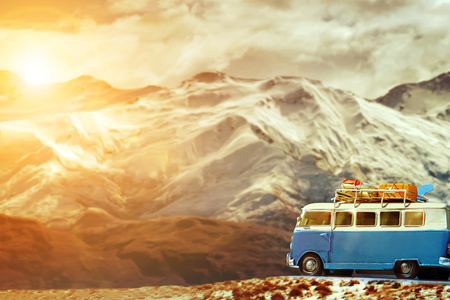 traveling car parking on road side against beautiful snow mountain background