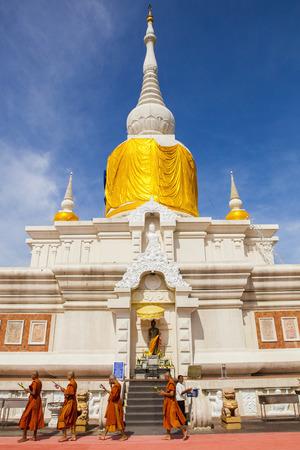 MAHASARAKHAM THAILAND - JULY8,2017 : thai buddha munk praying around Prathat Nadun pagoda most important buddhism place in Mahasarakham province north eastern of thailand