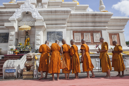 MAHASARAKHAM THAILAND - JULY8,2017 : thai buddha munk praying around Prathat Nadun pagoda most important buddhism place in Mahasarakham province north eastern of thailand
