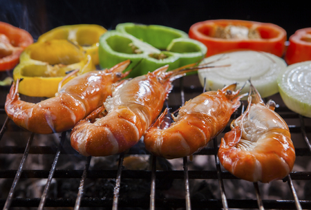 shrimp grilled on barbecue stove with chilly and onion ring