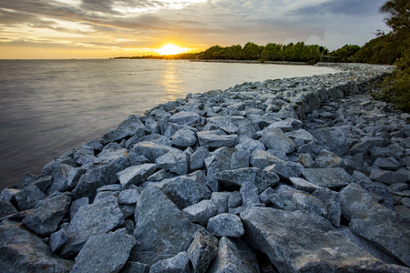rock dam protect coastal erosion in bangpoo thailand Stock Photo