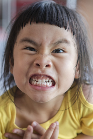 funny face of asian children grin ,toothy face Stok Fotoğraf - 82255763