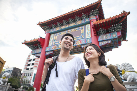 young asian backpacker happiness traveling destination in bangkok china town Standard-Bild