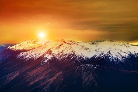 beautiful landscape sun rising sky over snowcaped mountain Stock Photo