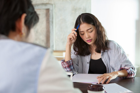 face of asian younger woman seriously thinking in family problem