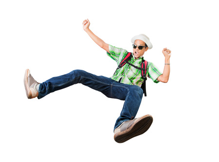 traveling backpack man happiness jumping isolated white background photo