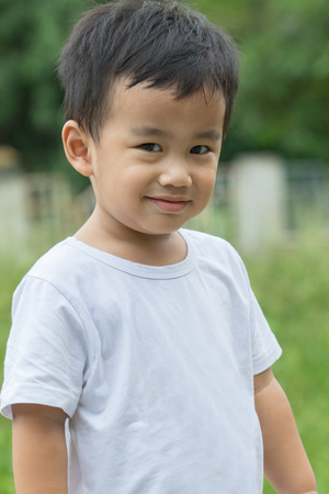 outdoor portrait head shot of asian children smiling face looking with eyes contact to camera Stock Photo