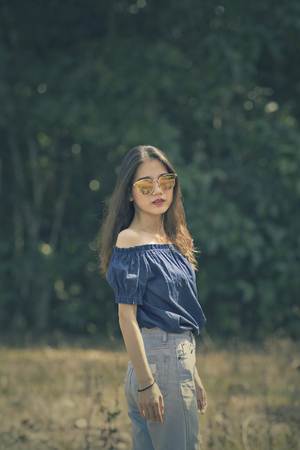 portrait of young asian woman outdoor cinema color process style Stock Photo