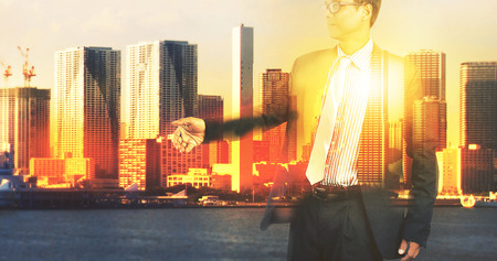 double exposure of business man and urban office building scene  photo