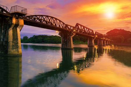 colorful twilight time of river khaw bridge in kanchanaburi, thailand Stock Photo