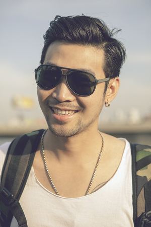 face of asian younger man toothy smiling face happiness emotion