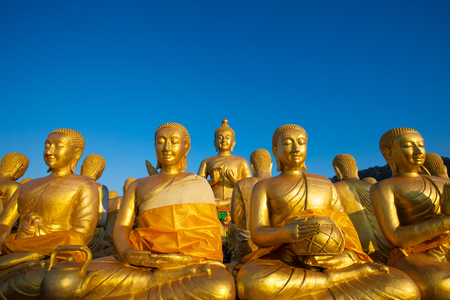 Buddha statue against clear blue sky in Thailand temple Stock Photo